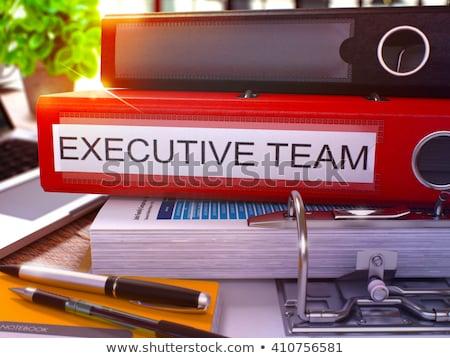 Executive Team on Red Office Folder. Toned Image. Stock photo © tashatuvango