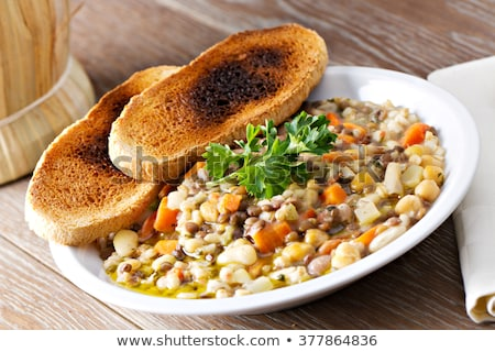 Barley Porridge in plate and spoon isolated. Healthy food for br Stock photo © MaryValery