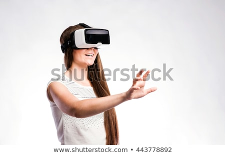 Digital composite of woman with a virtual reality simulator against digital gray pixelated 3d man Stock photo © wavebreak_media