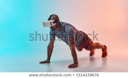 virtual reality goggle men_Sports & exercise Stock photo © toyotoyo
