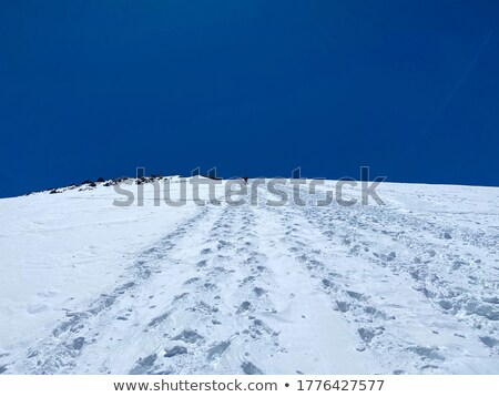 Man in the snowy mountains Stock photo © Anna_Om
