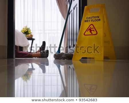 Woman Cleaning Floor With Wet Floor Caution Sign Stock photo © AndreyPopov