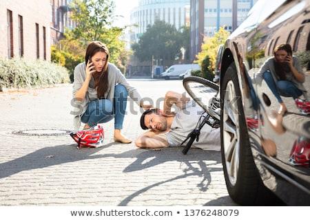 Nő hív segítség eszméletlen férfi kerékpáros Stock fotó © AndreyPopov