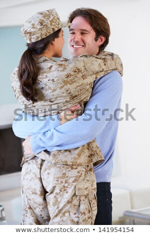 Soldier Visiting Home On Leave Hugging Wife Stock photo © HighwayStarz