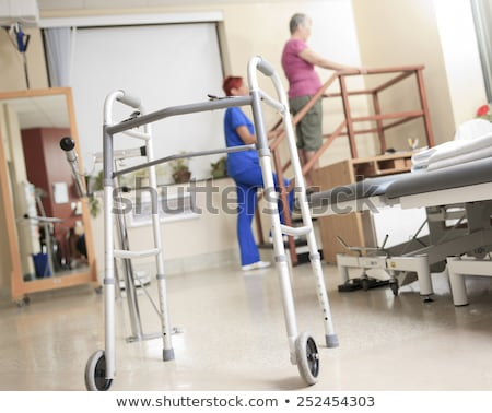 Elderly lady with her physiotherapist in a hospital Stock photo © Lopolo