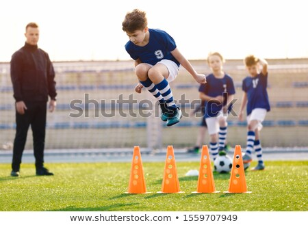 Soccer Training Unit. Boys Improving Soccer Drills and Skills. Young Coach Coaching  Kids on the Fie Stock photo © matimix