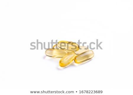 Witamina d złoty omega 3 pigułki zdrowa dieta odżywianie Zdjęcia stock © Anneleven
