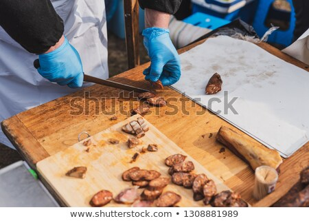 Piece of the pumpernickel in hand Stock photo © RuslanOmega