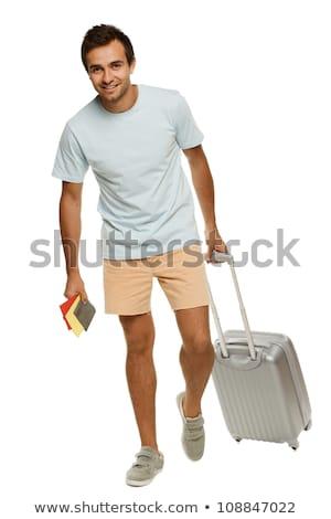 Caucasian Man Traveling Pulling Suitcase and Passport Isolated W stock photo © Qingwa