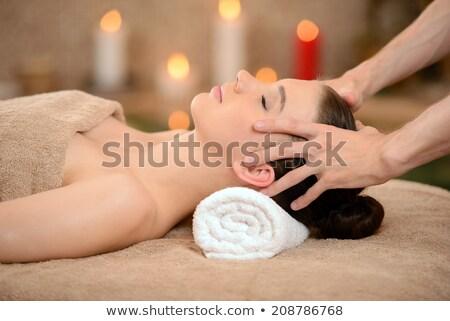 beautiful woman being massaged Stock photo © photography33