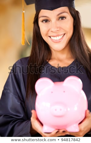 Stock photo: Woman Holding Her College Fund