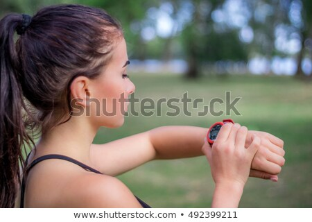 Young woman with stop watch Stock photo © photography33