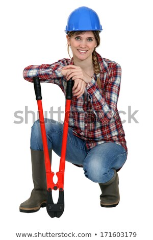 Woman kneeling by bolt cutters Stock photo © photography33