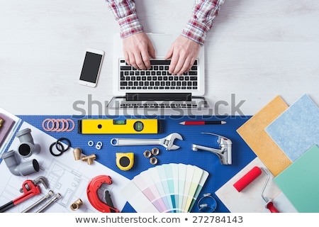 Tiler with a phone and laptop Stock photo © photography33