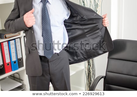 Man taking off his jacket Stock photo © photography33