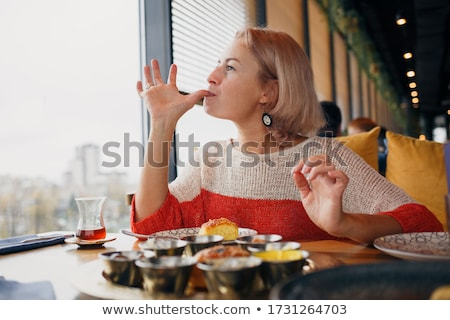 Young girl licking her fingers Stock photo © photography33