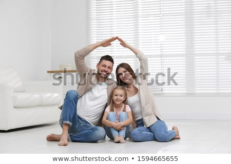 Child and man's hand forming a house. Family house concept. Stock photo © Len44ik