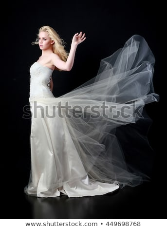 Beautiful bride in luxurious wedding dress isolated on white bac Stock photo © Victoria_Andreas
