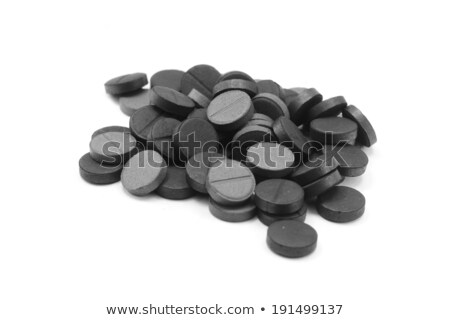 Poucos carbono pílulas isolado branco pílula Foto stock © digitalr