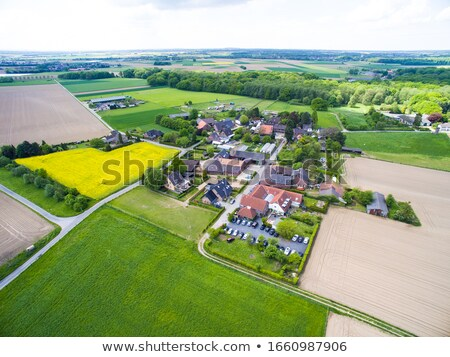 aerial of small village with fields and river rhine Stock photo © meinzahn