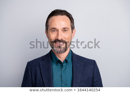 attractive business man closing his jacket Stock photo © feedough