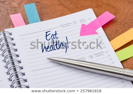 Daily planner with the entry Eat healthy Stock photo © Zerbor