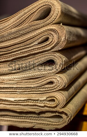 pile of old newspapers on the shelf stock photo © valeriy
