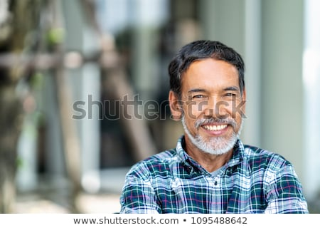 White-haired retired man looking at the camera Stock photo © ozgur