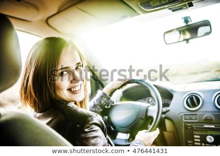 Fiatal nő mögött kormánykerék autó lány utazás Stock fotó © tommyandone