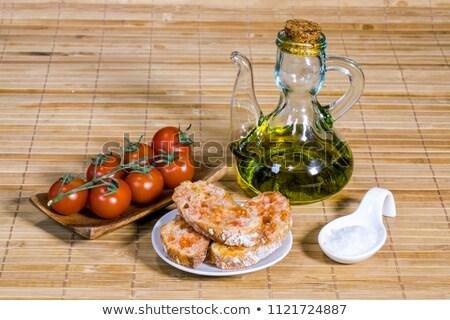 Olive oil, tomatoe and bread Stock photo © marimorena