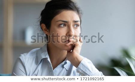 close up of thoughtful woman looking away stock photo © wavebreak_media