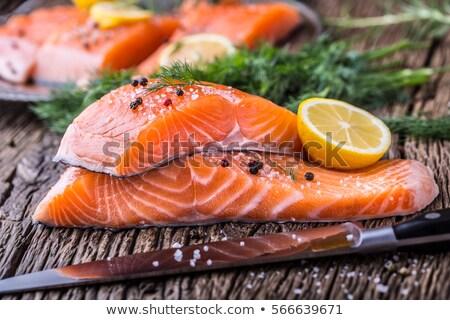 Nyers lazac hal filé fa deszka közelkép Stock fotó © yelenayemchuk