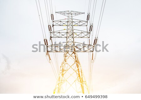 Silhouette of electrical pylon over blue sky stock photo © blasbike