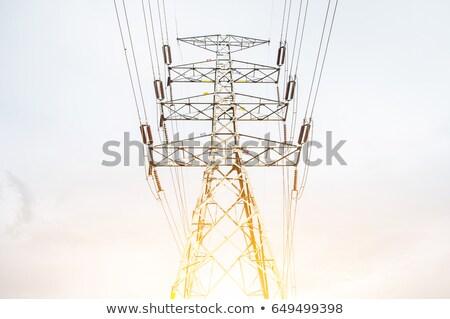 Silhouette of electrical pylon over blue sky Stock photo © blasbike