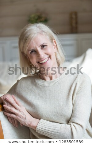 Pretty vivacious woman sitting laughing Stock photo © Giulio_Fornasar