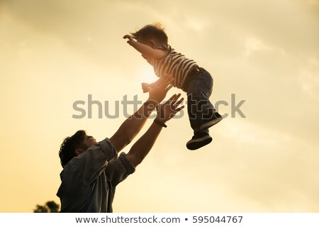 Father throwing Son in the air Stock photo © IS2