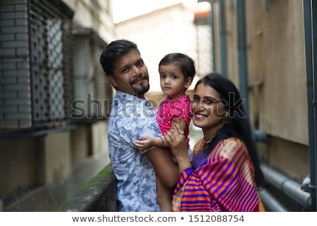 Family laughing together on lane Stock photo © IS2