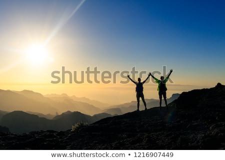çift · hikers · başarı · dağlar · gün · batımı · silah - stok fotoğraf © blasbike