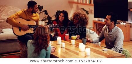 quatro · amigos · suv · guitarra · comunicação · sorridente - foto stock © is2