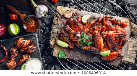 Chicken wings with lime slices Stock photo © dash