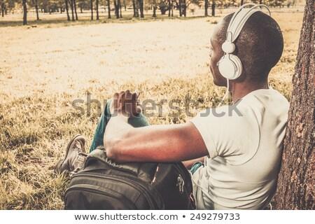 Pozitív fiatal afrikai fickó hátizsák sétál Stock fotó © deandrobot