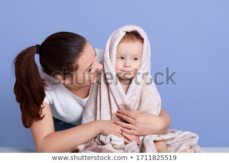 Mother looking at woman bathing her baby Stock photo © Kzenon