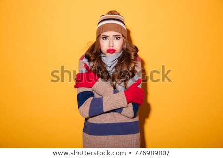 Portrait of a frozen young woman dressed in sweater Stock photo © deandrobot
