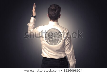 Businessman standing with maze on his back Stock photo © ra2studio