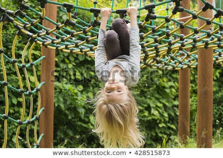 Portrait of Happy little blond girl playing upside down Stock photo © Lopolo