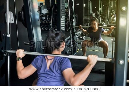 Fitness Woman Exercising Her Legs On Machine Stock photo © Jasminko
