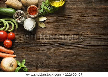 Fresh rosemary herb on rustic wooden background. Stock photo © marylooo