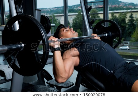 Effort On The Bench Press Exercise Machine Stock photo © Jasminko
