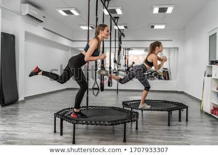 sport blond makes exercise with rope stock photo © paha_l