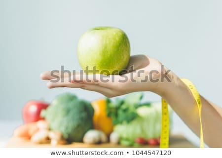 médico · médico · maçã · mulher · jovem - foto stock © redpixel